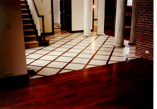 Ceramic inlayed with American Cherry Select, adjoining a dining room with  American Cherry wood - Flooring Selections